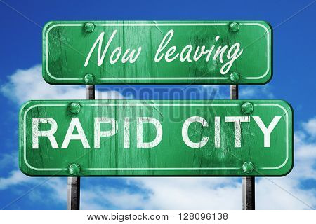 Leaving rapid city, green vintage road sign with rough lettering