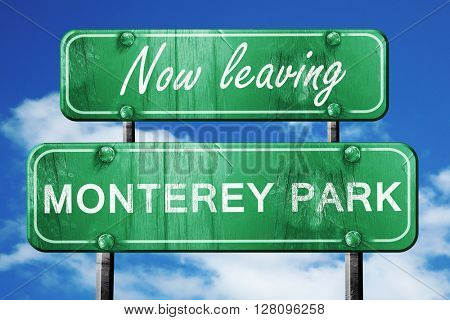 Leaving monterey park, green vintage road sign with rough letter