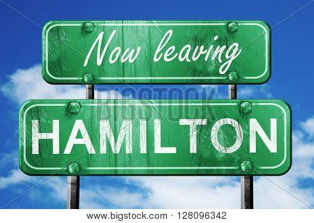 Leaving hamilton, green vintage road sign with rough lettering