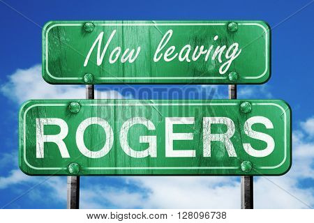 Leaving rogers, green vintage road sign with rough lettering