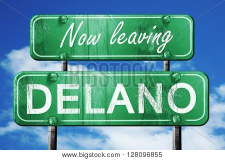 Leaving delano, green vintage road sign with rough lettering