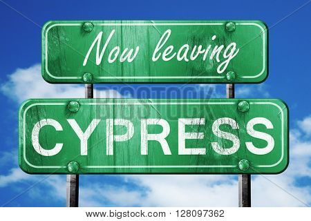 Leaving cypress, green vintage road sign with rough lettering