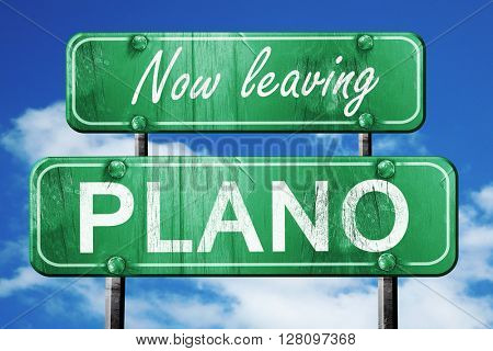 Leaving plano, green vintage road sign with rough lettering