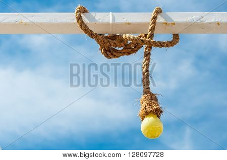 Yellow bulb with rope on steel tube
