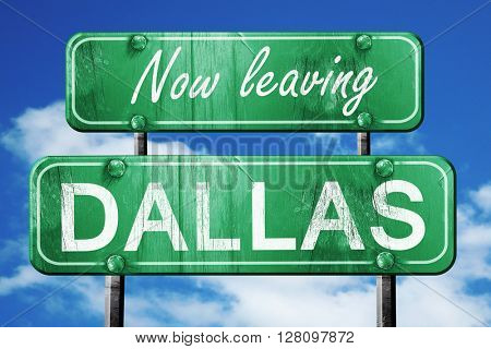 Leaving dallas, green vintage road sign with rough lettering