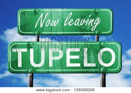 Leaving tupelo, green vintage road sign with rough lettering