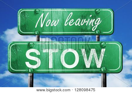 Leaving stow, green vintage road sign with rough lettering