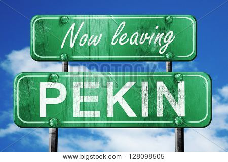 Leaving pekin, green vintage road sign with rough lettering