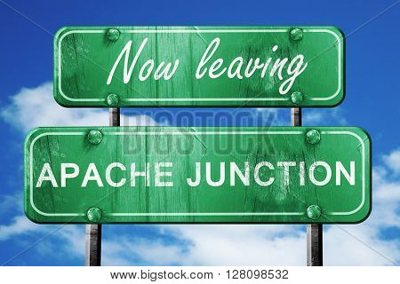 Leaving apache junction, green vintage road sign with rough lett