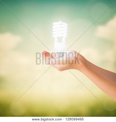 Hands Of Little Girl Holding Light Bulb
