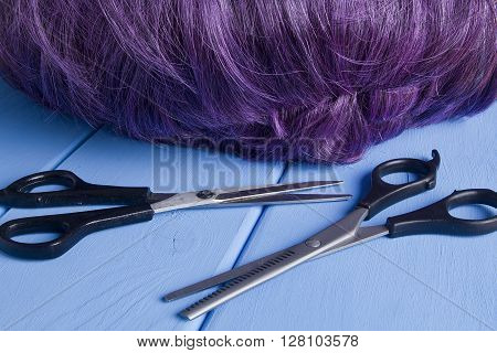 hairdressing equipment like different scissors on wooden table in professional hairdressing salon