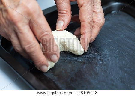 Cassava bread preparation : Placing colombian cassava bread (Pandeyuca) on baking sheet