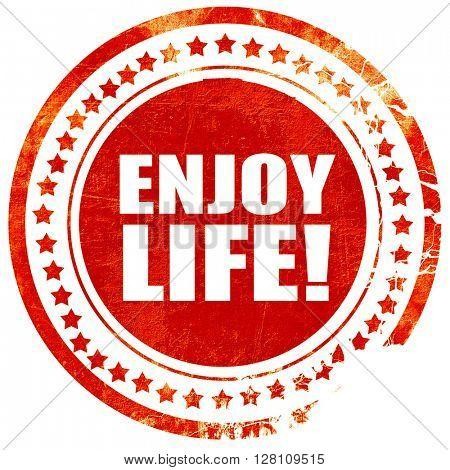 enjoy life!, red grunge stamp on solid background