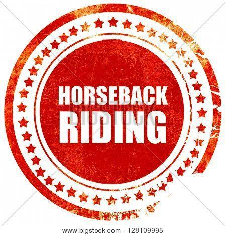 horseback riding, red grunge stamp on solid background