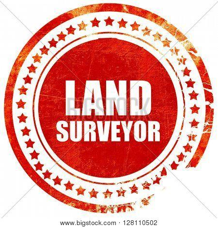 land surveyor, red grunge stamp on solid background