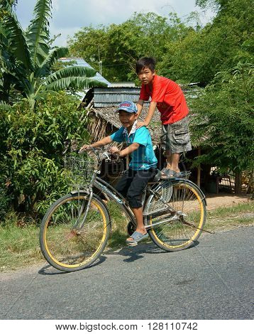 Asian Children Ride Bicycle In Danger