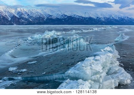 Large blocks of ice crack. Beautiful winter landscape in the Lake Baikal.