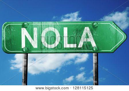 Nola road sign, 3D rendering, vintage green with clouds backgrou