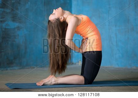 Beautiful Woman Practicing Kneeling Quad Stretch