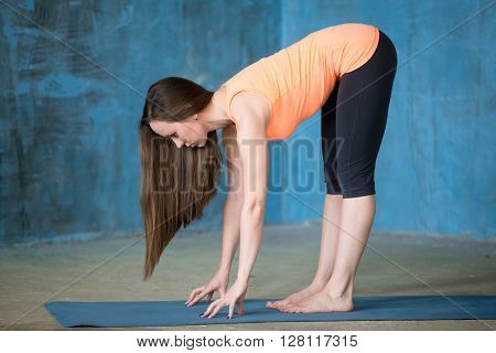 Sporty Attractive Young Woman Doing Ardha Uttanasana Pose