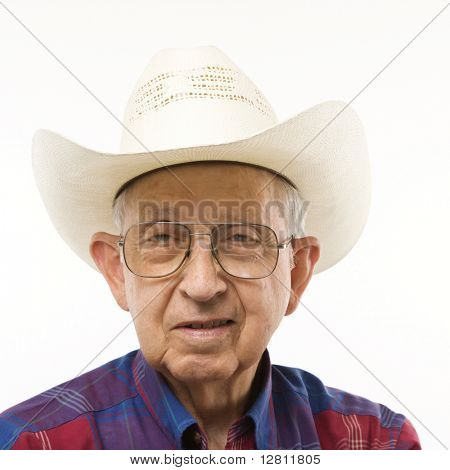 Portrait of Caucasion elderly man wearing plaid shirt and cowboy hat.