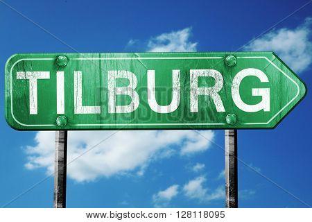 Tilburg road sign, 3D rendering, vintage green with clouds backg