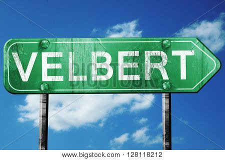 Velbert road sign, 3D rendering, vintage green with clouds backg