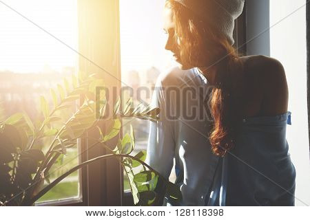 Pretty Hipster Girl With Bare Shoulder Sitting On The Windowsill Waiting For Her Friends To Go Out F