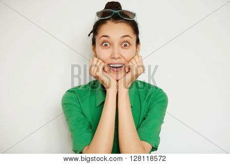 Cropped Isolated View Of Surprised Brunette Student Girl Leaning On Her Elbows, Looking At The Camer