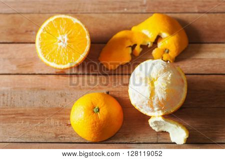 Orange fruit and slice on wooden table background in still life tone