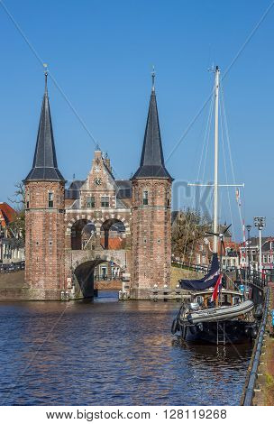 SNEEK, NETHERLANDS - APRIL 11, 2016: Water gate and ship in the historical city Sneek, Netherlands