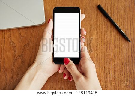 Cropped Portrait Of Student Girl Surfing Internet On Mobile Phone While Doing Homework. Close Up Of