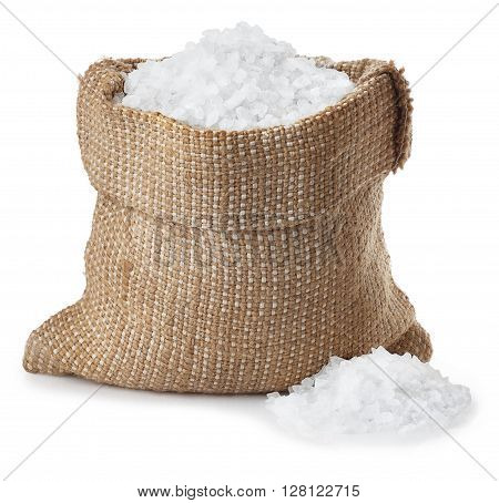 Sea salt in bag with heap isolated on white background. Condiment crystals of sea salt