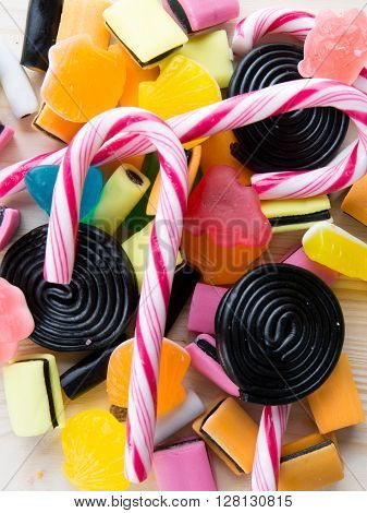 Lots Of Colorful Candies On A Wooden Table Background
