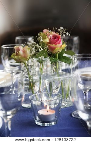Table decoration with roses and glasses for an informal festive celebration like birthday baptism wedding or a special dinner selected focus narrow depth of field