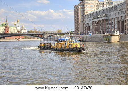 MOSCOW RUSSIA - May 02.2016: Little tug sailing on the river Moskvaon a background Kremlin