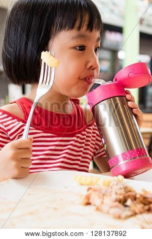 Asian Little Chinese Girl Drinking Water From Stainless Steel Bottle