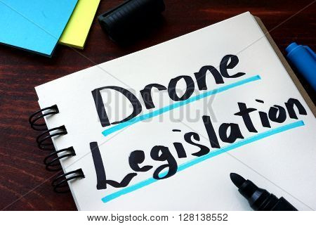 Drone Legislation written on a notepad with marker.