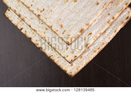 Matzo on brown table close up photo