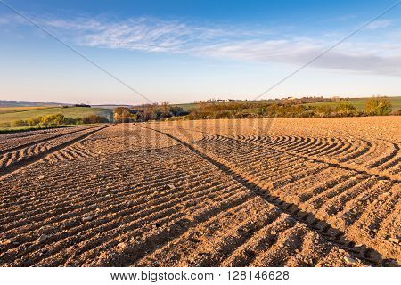 Spring Rural Countryside With Ruts In Plowed Field