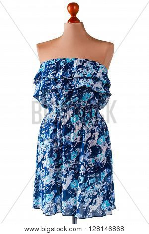 Strapless blue summer dress. Floral dress on beige mannequin. Lady's blue casual dress. Nice discounts in outlet shop.