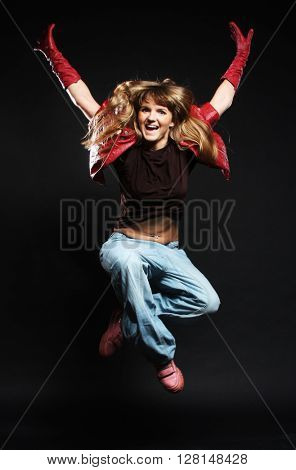 young female dancing on the black background