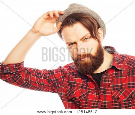 Young hipster man wearing hat. Studio shot over white background.
