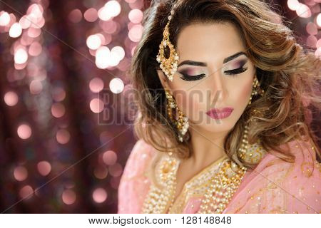 Fashion Portrait of a Beautiful female model in creative makeup and styling