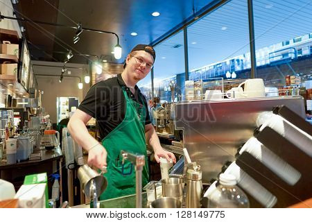 CHICAGO, IL - CIRCA MARCH, 2016: inside of Starbucks Cafe. Starbucks Corporation is an American global coffee company and coffeehouse chain based in Seattle, Washington