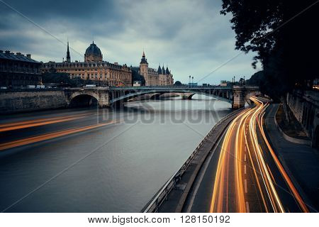 River Seine with bridge and traffic light trail