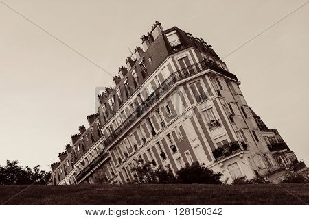 French style building behind a slope. Paris