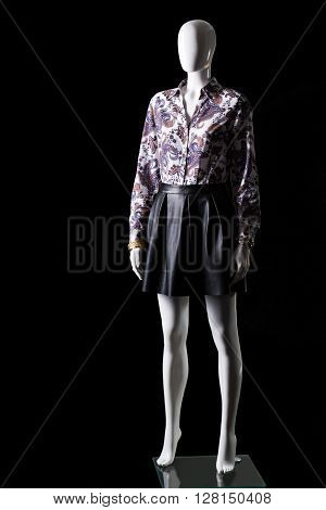 Black skirt, shirt and accessories. Mannequin wearing shirt with skirt. Woman's luxury evening apparel. High-quality clothing in stock.