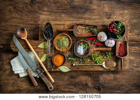 Various colorful spices on wooden table