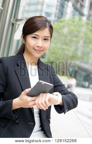 Businesswoman use cellphone and smart watch